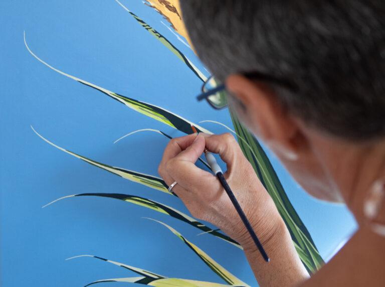 The artist Helen Purdie painting in her Studio in Torrox, Spain